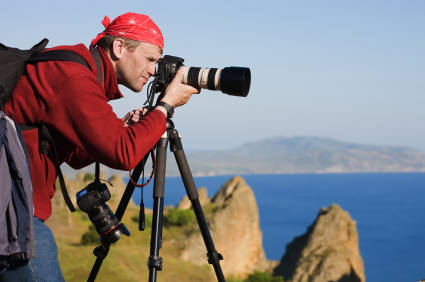 Photographer with camera on tripod